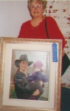 008 - shirley with painting of glenn and oria